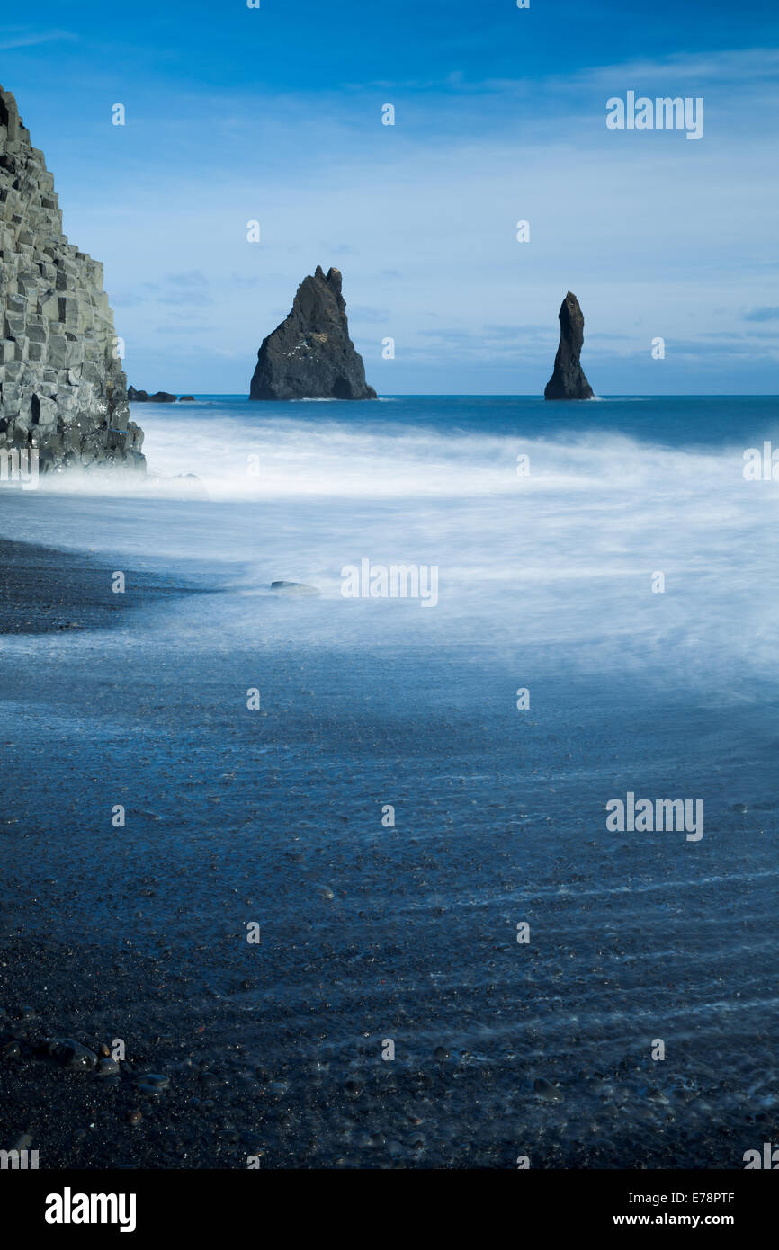 the Reynisdrangar basalt sea stacks and the Reynisfjara black sand beach near the village Vík í Mýrdal, - Stock Image