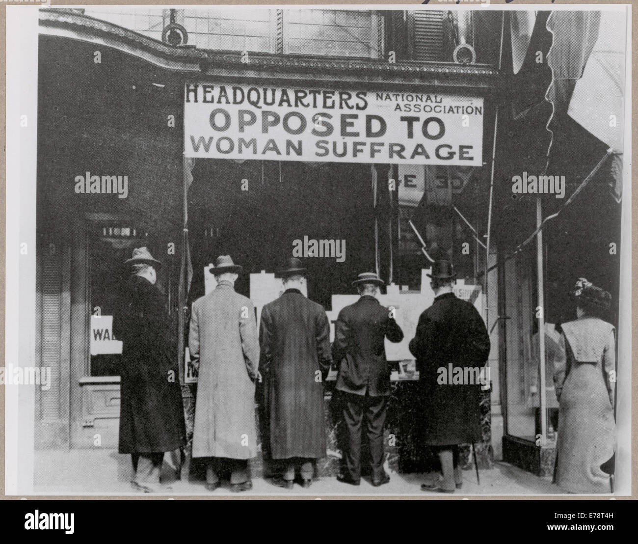 Passers-By Looking at Window Display at the Headquarters of National Association Opposed to Woman Suffrage, ca. - Stock Image