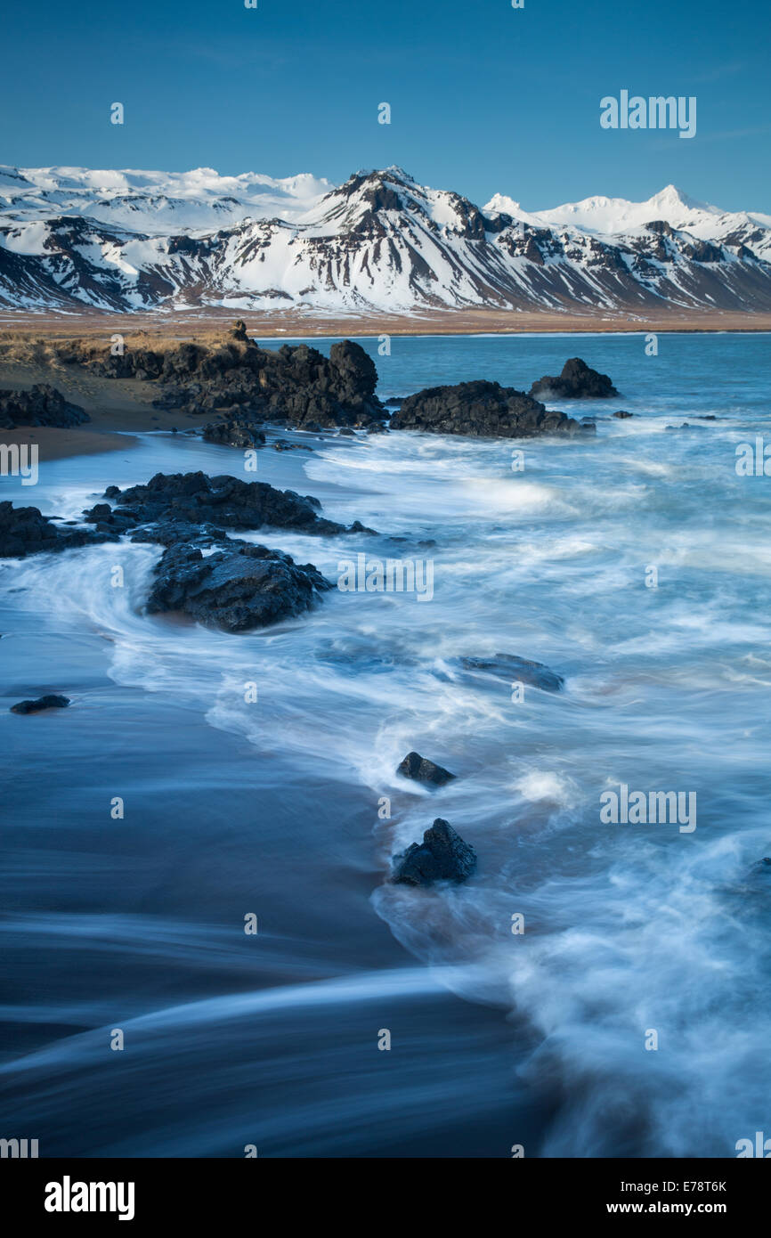 the coast at Budir with the mountains of Holsfjall and the Snaefellsnes Peninsula, Western Iceland - Stock Image