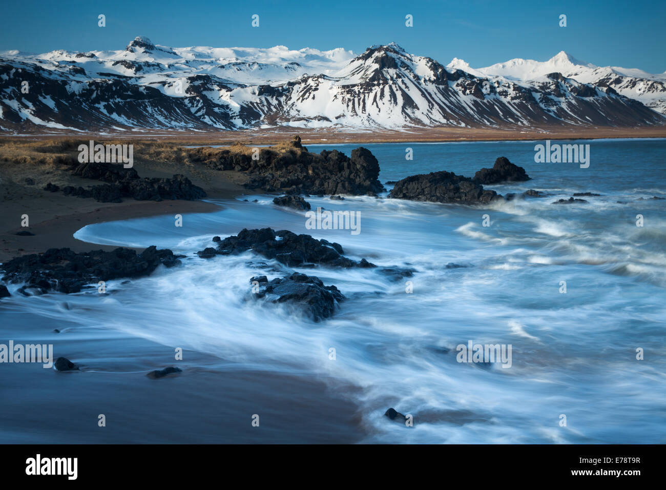 the coast at Budir with the mountains of Holsfjall and the Snaefellsnes Peninsula , western Iceland - Stock Image