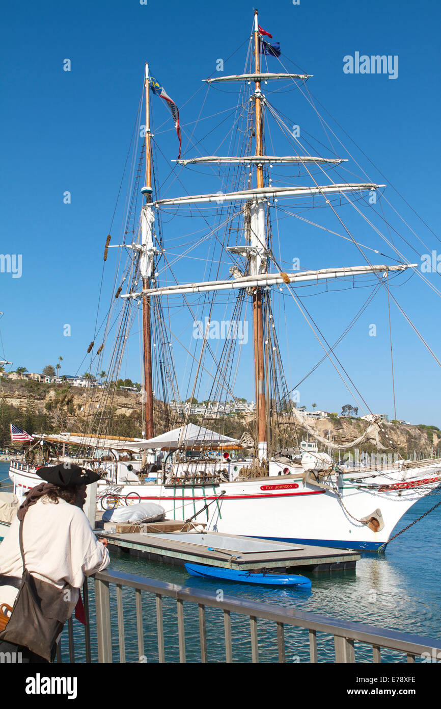 A Pirate views The brigantine Exy Johnson at the 30th Annual Toshiba Tall Ships Festival Dana Point Harbor Southern - Stock Image