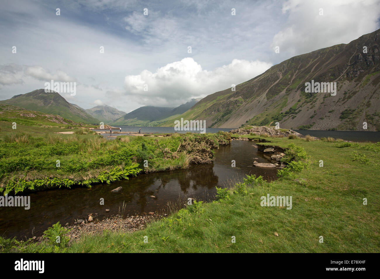 Wastwater lake surrounded by mountain peaks coated with green vegetation, draped with low cloud, Lake District, - Stock Image