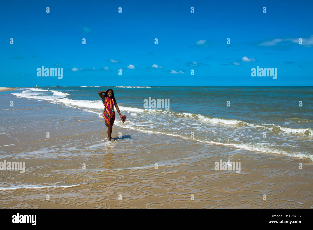 A Malagasy beauty walking on the beach in Morondava, Madagascar. - Stock Image
