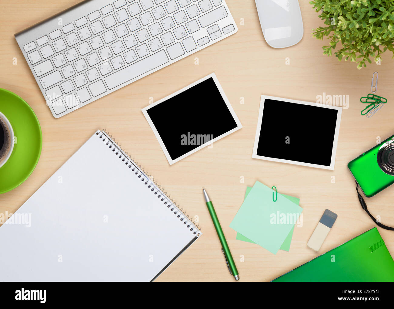 Photo Frames On Office Table With Notepad Computer And Camera View