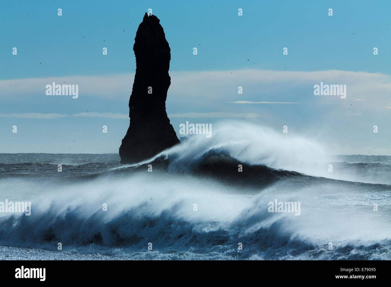 waves breaking on Renisfjara beach in front of the Reynisdrangar basalt sea stacks, southern Iceland - Stock Image