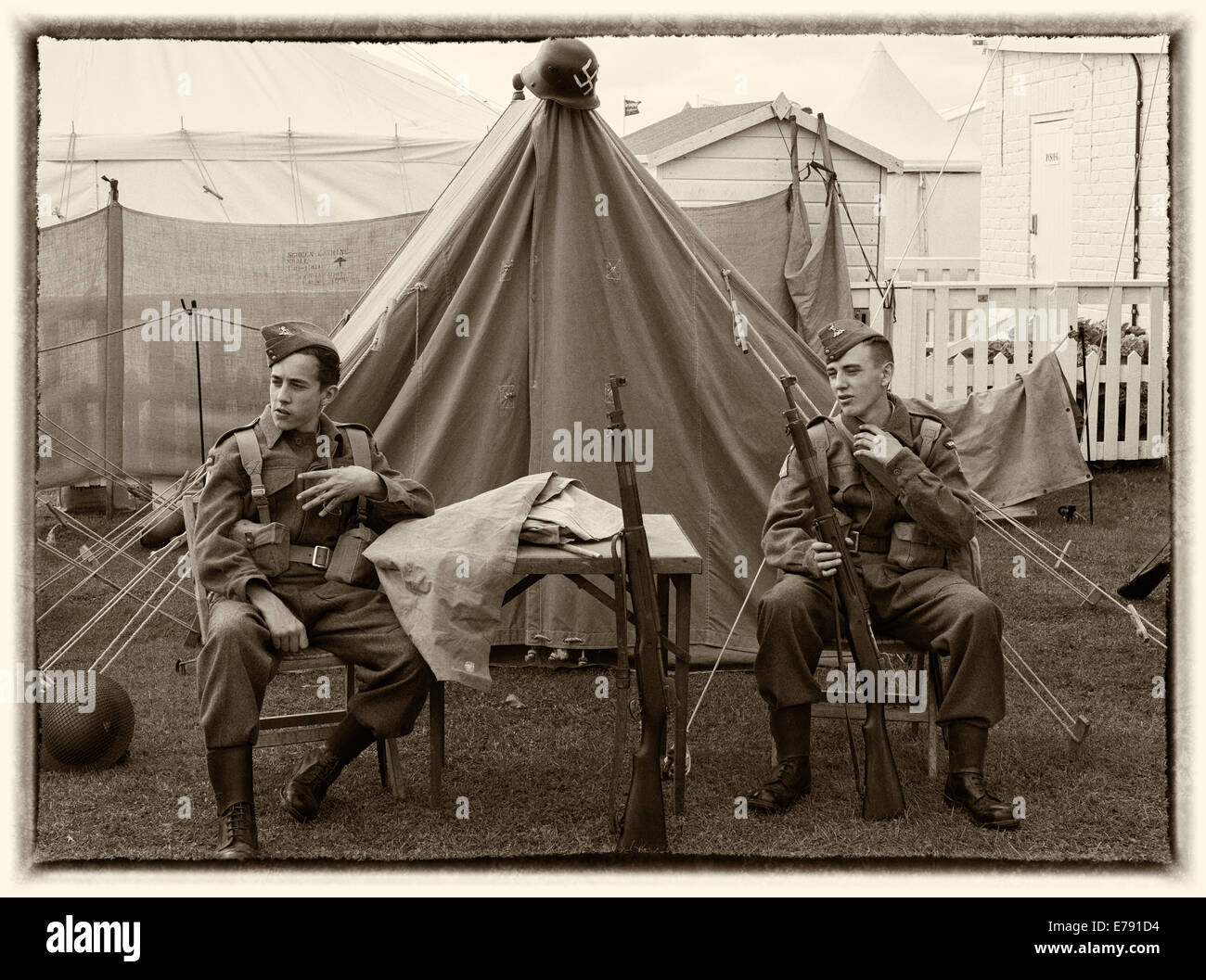 Home guards outside tent - Stock Image