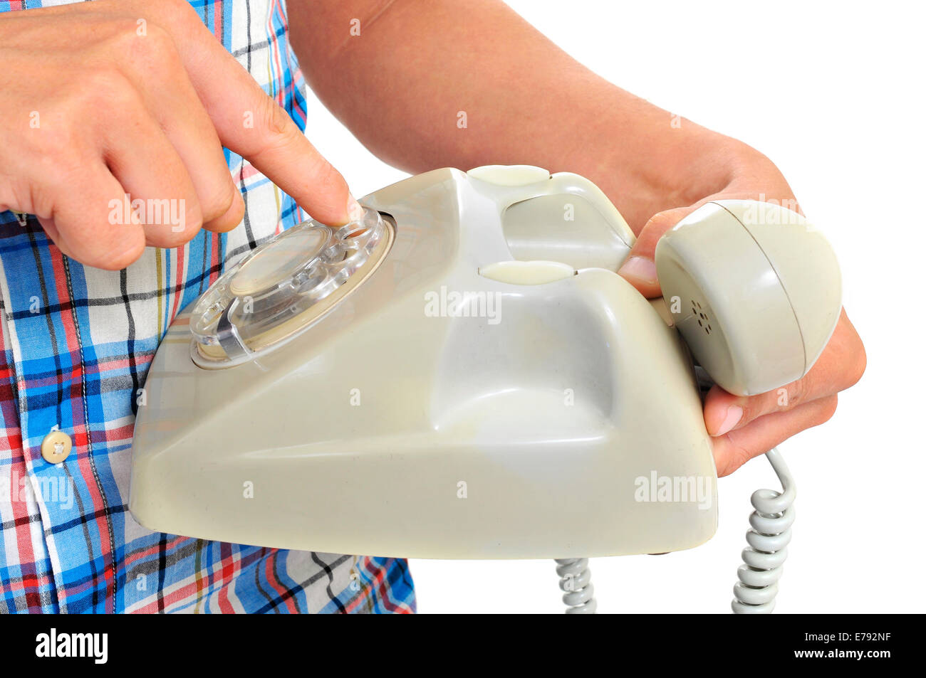 detail of a young man dialing in a rotary dial telephone - Stock Image