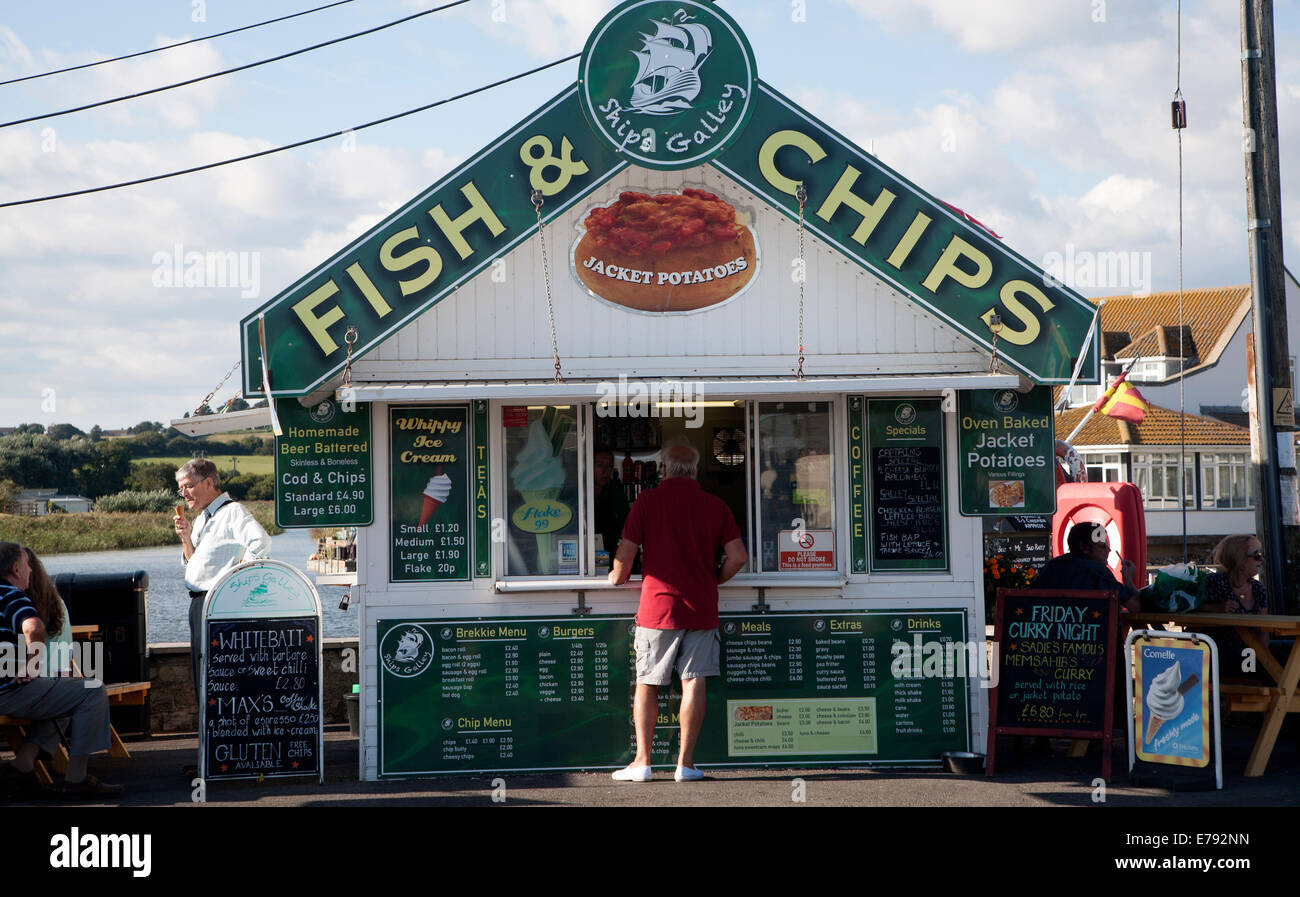 Traditional seaside Fish and Chips small shop booth at West Bay, Bridport, Dorset, England - Stock Image