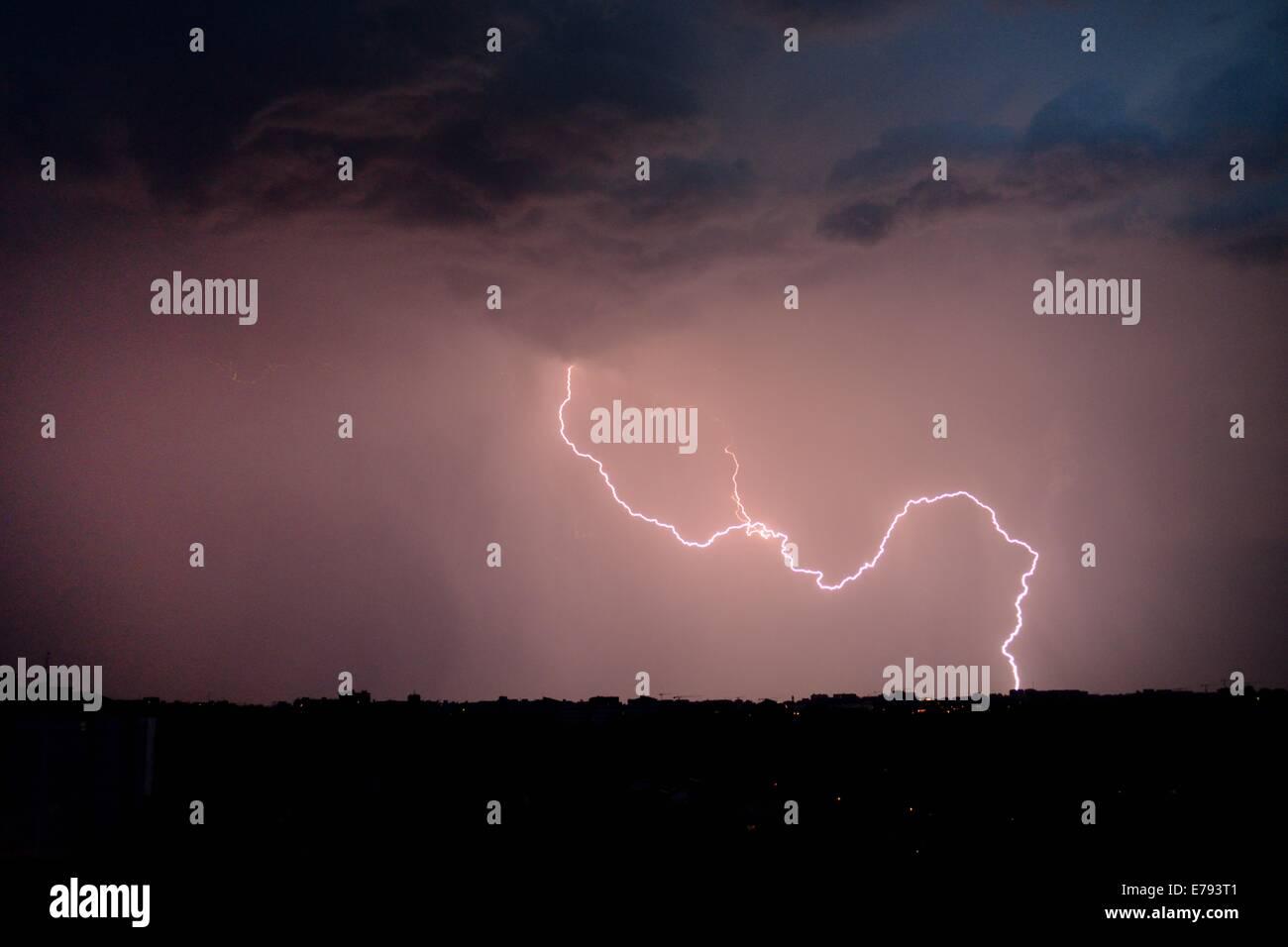 lightning bolt in night sky over the horizon Stock Photo