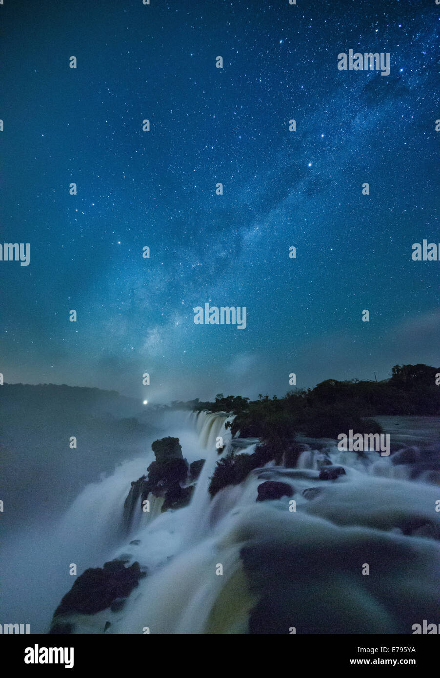 the Milky Way over Iguazu Falls at night, Argentina - Stock Image