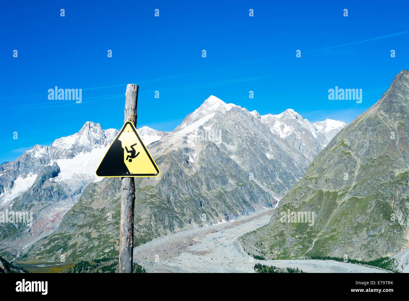 COMBAL, ITALY, AUGUST 28: Slippage danger sign with Miage Glacier and Combal peaks in the background. The area is - Stock Image