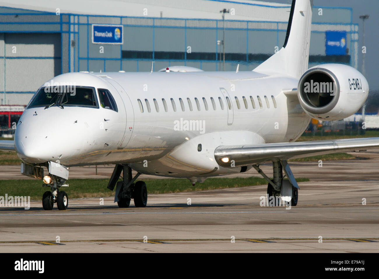 FlyBe Embraer 145 enters runway 23L at Manchester airport. - Stock Image