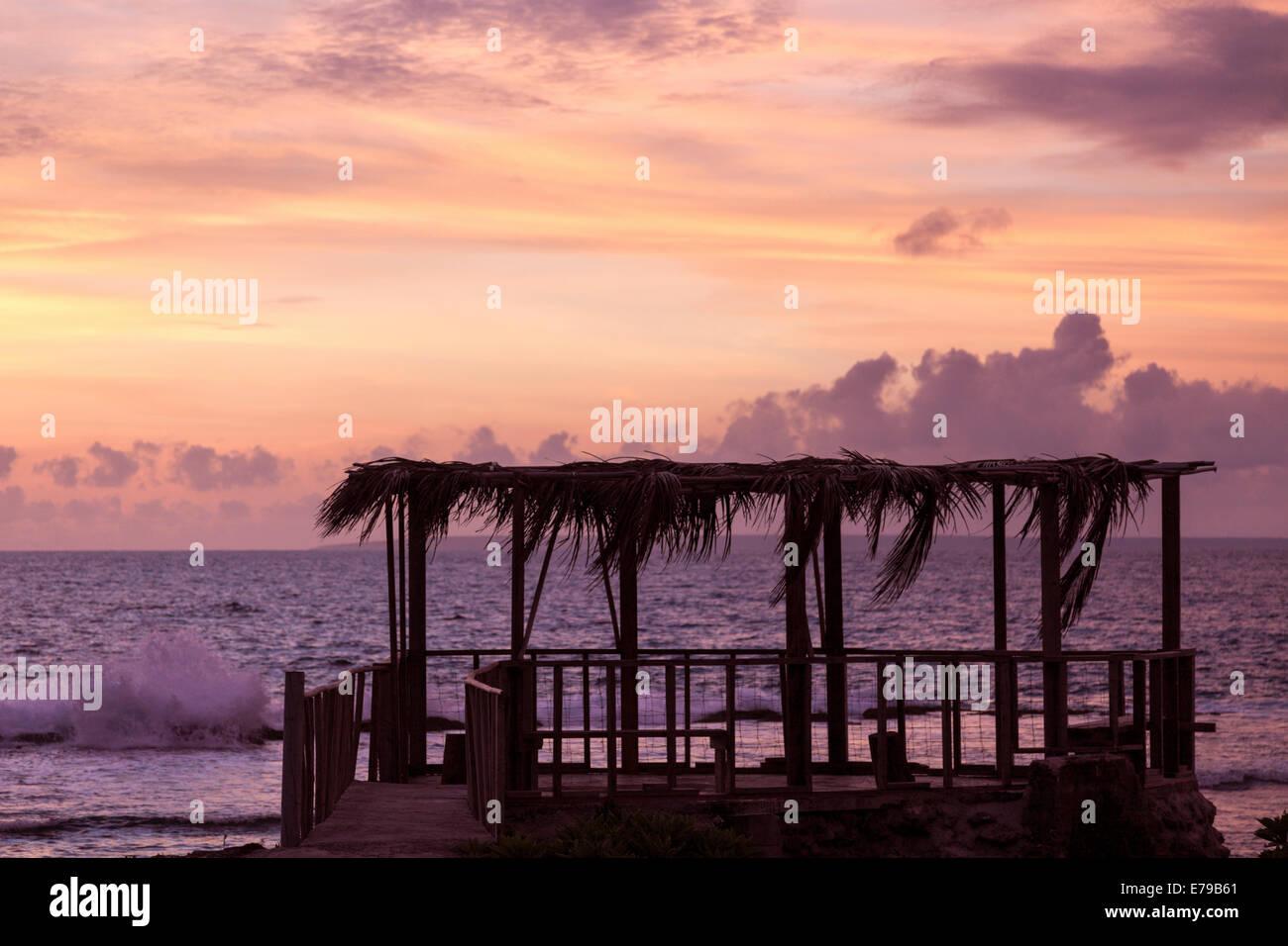 Tongan sunset - Eua Island. Tongatapu in the background. Stock Photo