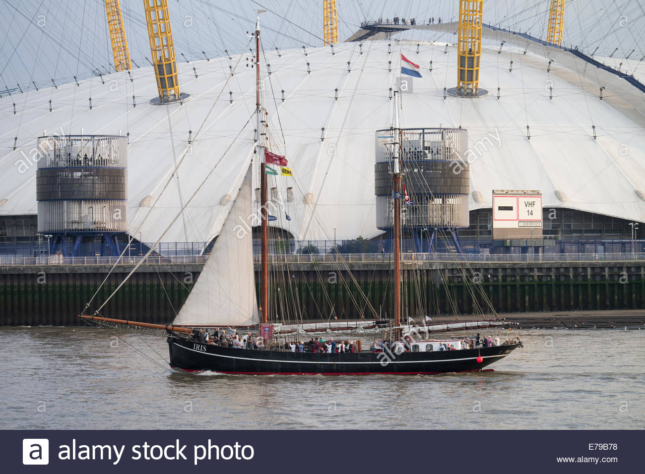 The 2014 Tall Ships Festival, London: traditional Dutch herring-lugger, Iris, passing the O2 Arena at Greenwich. - Stock Image