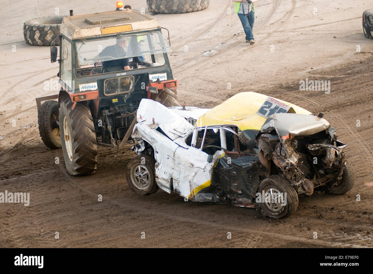 banger racing car cars old mot failure being dragged off towed by a tractor wrecked roadside assistance breakdown - Stock Image