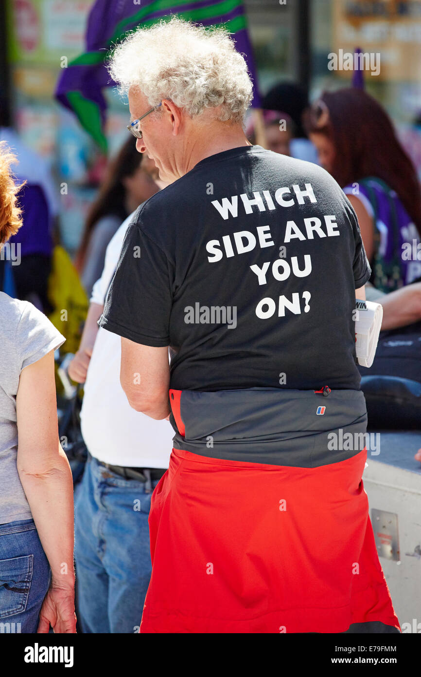 Man wearing political statement t-shirt at a protest rally about low public sector worker pay - Stock Image