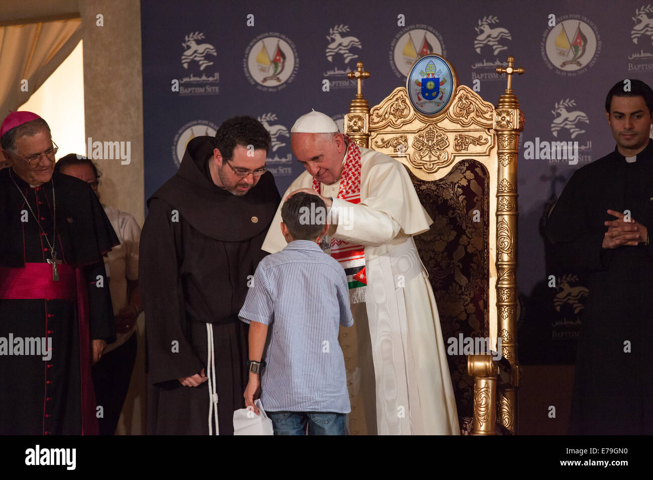5be8bb453bbb Pope Francis blesses a Syrian refugee during his visit to the Catholic  church at the Baptism