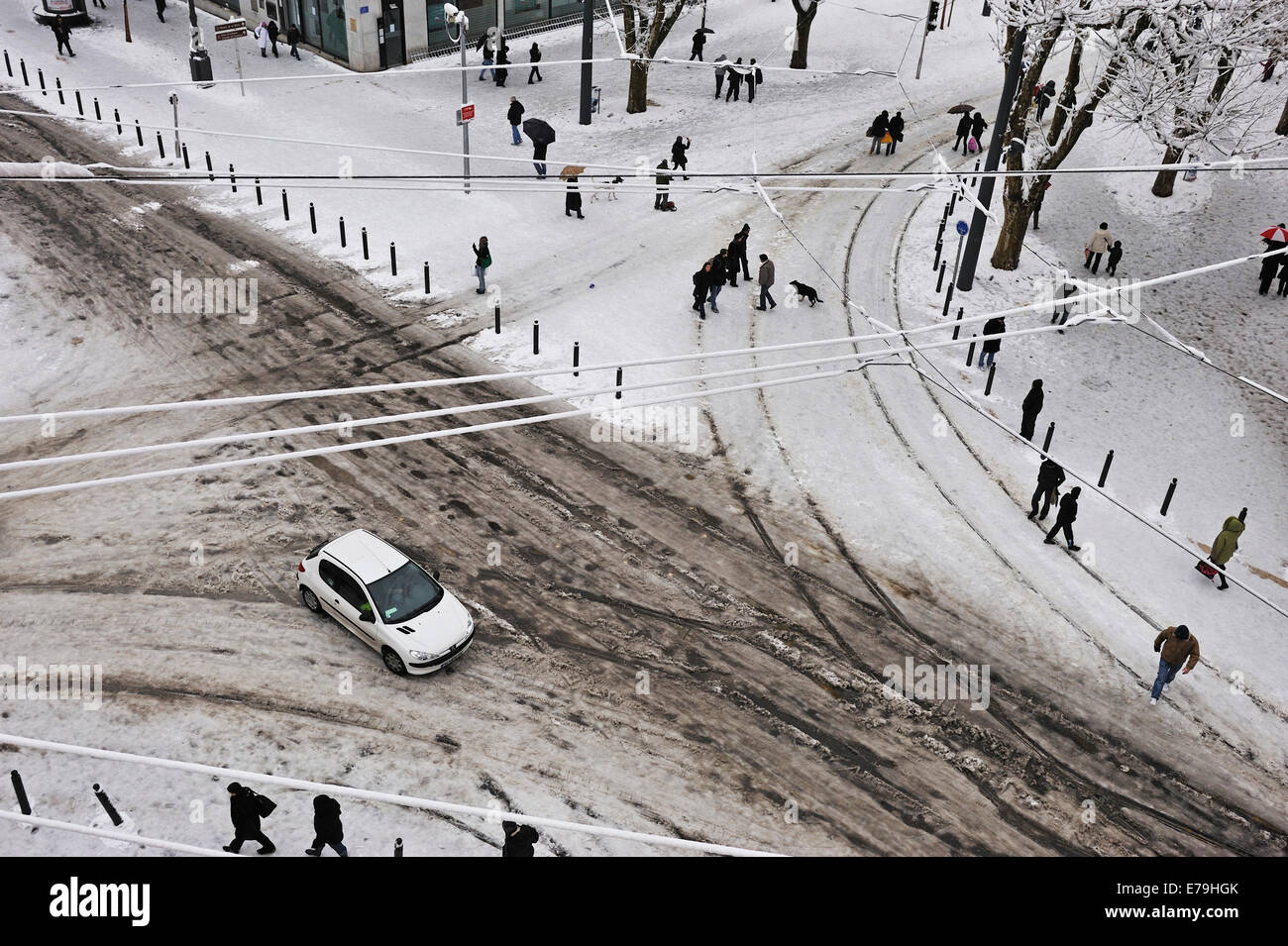 City centre road junction and streets in winter after heavy snow - Stock Image