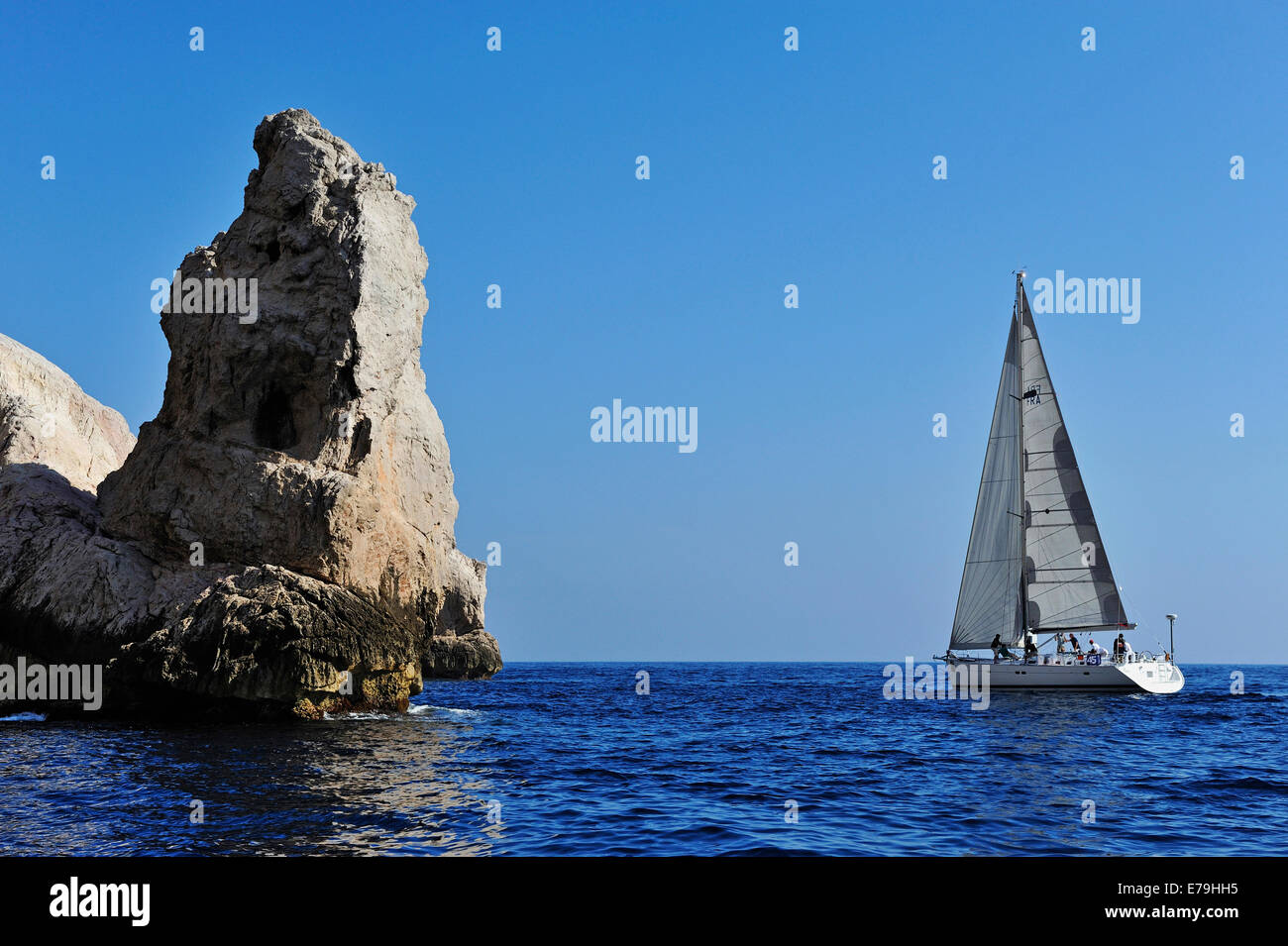Sailboat by Riou island rocks in the Mediterranean Sea, Marseille, France, Europe - Stock Image