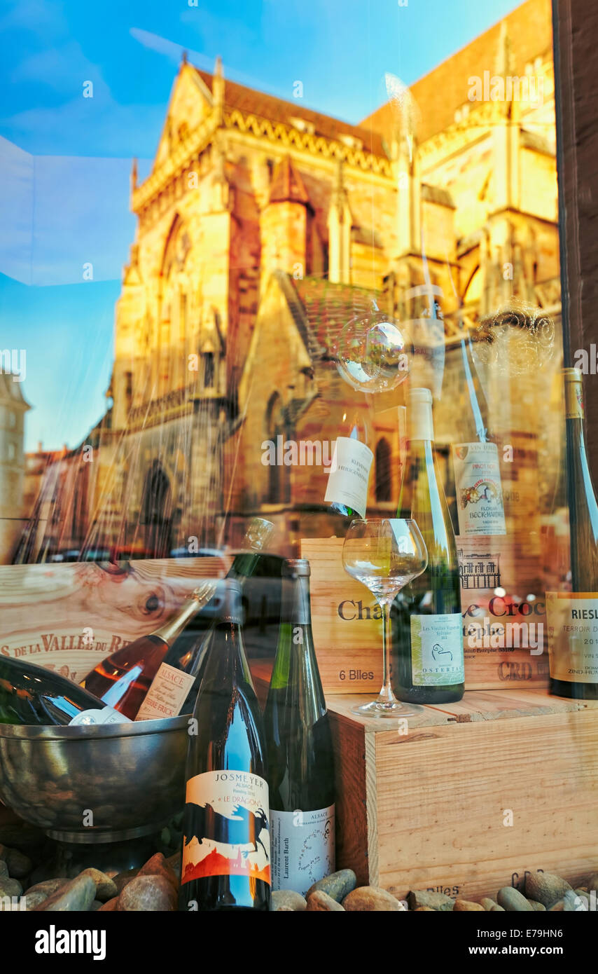 Wine shop with Saint Martin«s church reflection at the city center. Colmar, Haut-Rhin, Alsace, France. Stock Photo