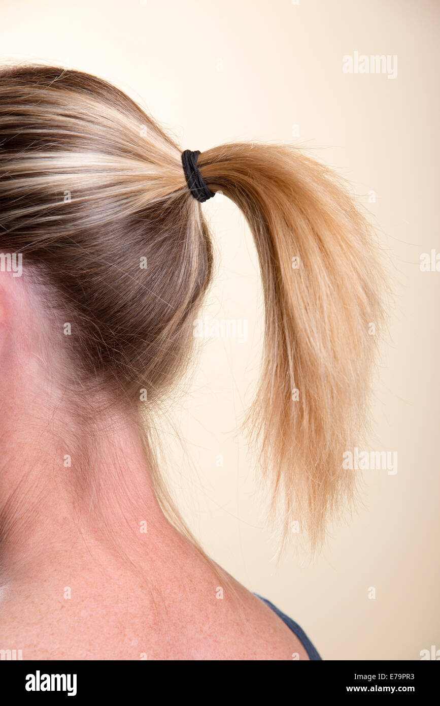 Woman With Ponytail Hairstyle Tied Back With A Rubber Band Stock
