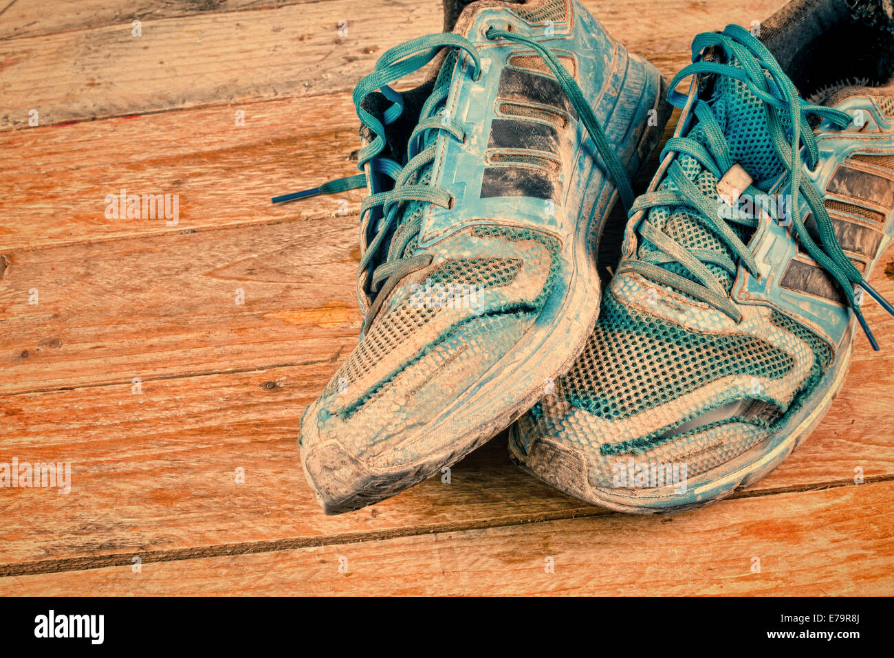 Very dirty and worn out sports shoes - Stock Image