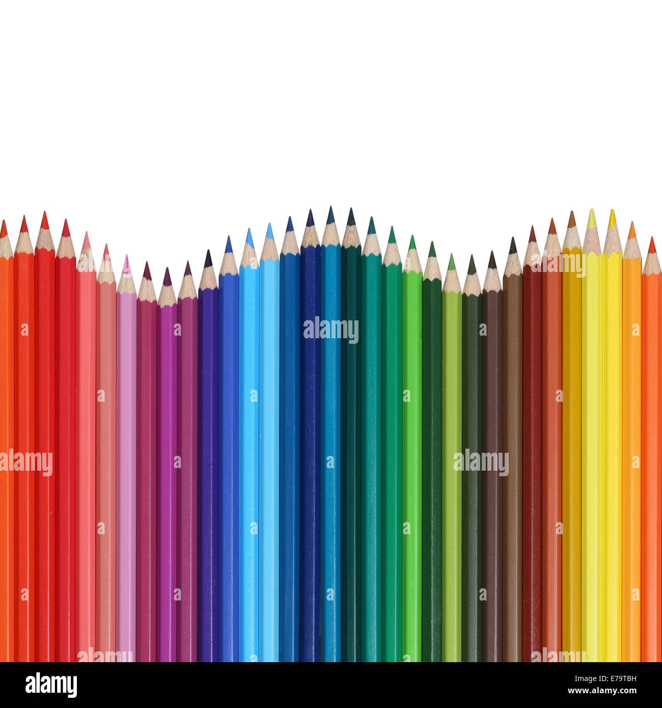School supplies colored pencils forming a wave business boom and recession - Stock Image