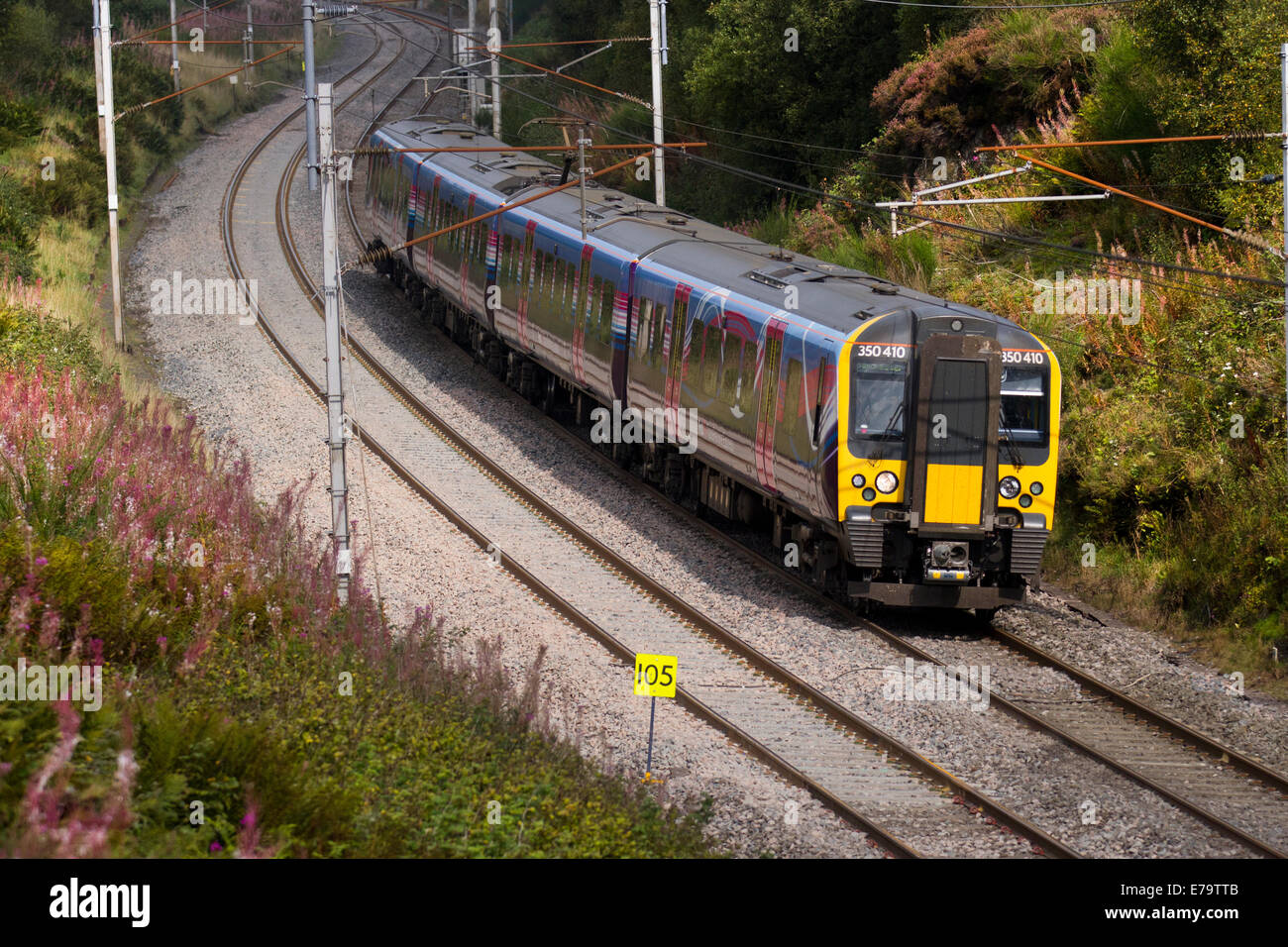 Power lines, and gantries for electric trains   British Rail Class 350 410 Desiro British Railways  Descending Train Stock Photo