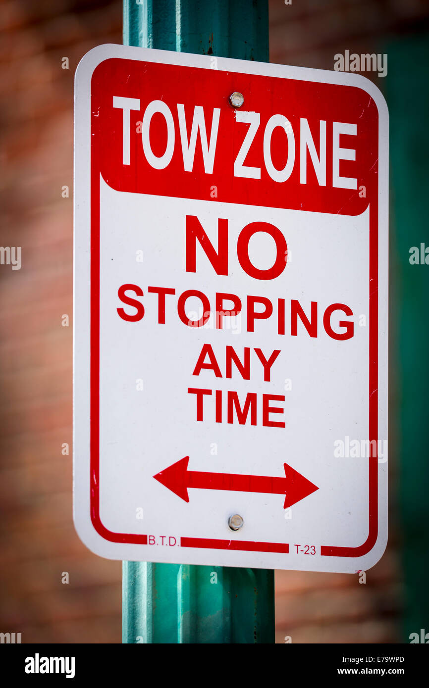 Tow Zone - NO Stopping at any time - Time. USA - Stock Image