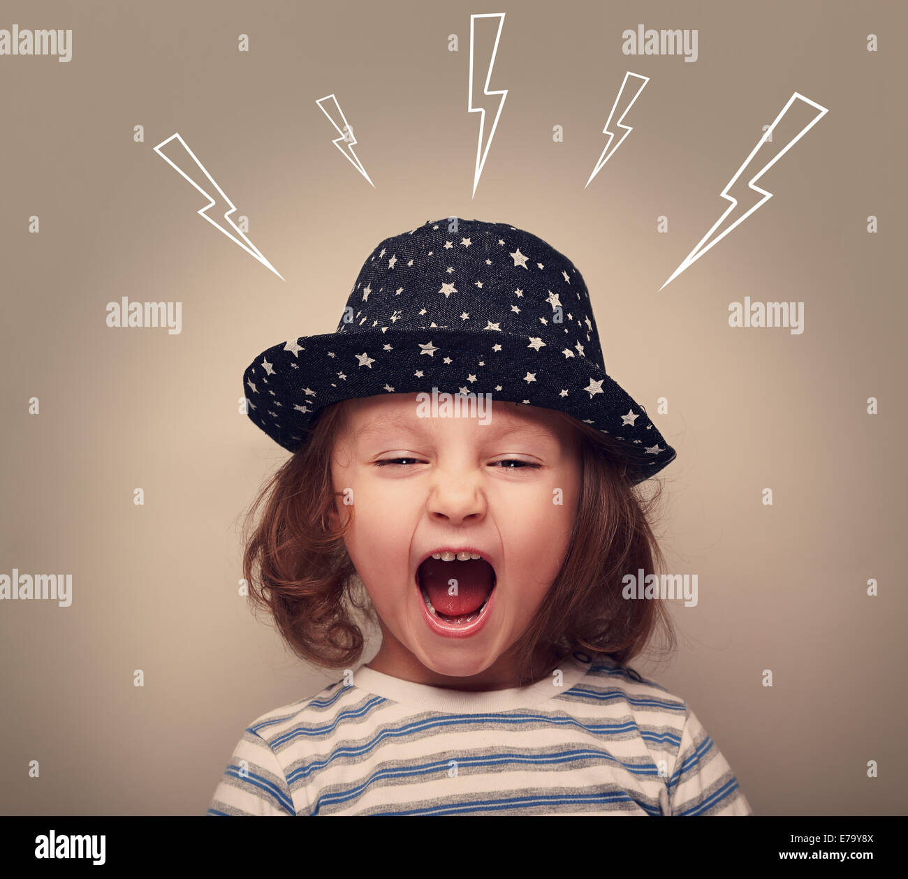 Shouting angry small kid with open mouth and lightnings above - Stock Image