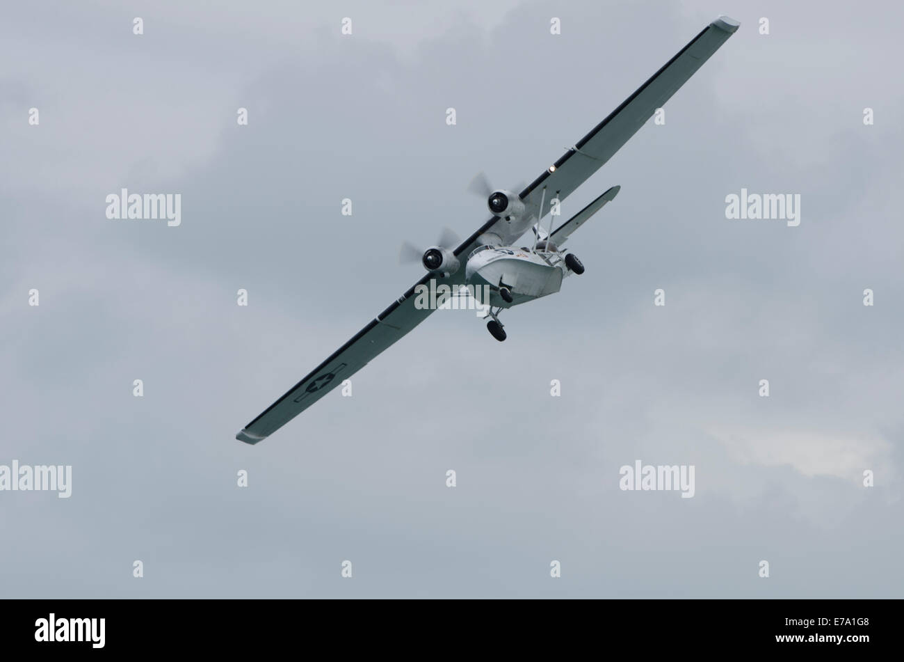 Consolidated Catalina Flying Boat displaying at Airwaves Air Show Portrush 2014 with normal landing gear down - Stock Image