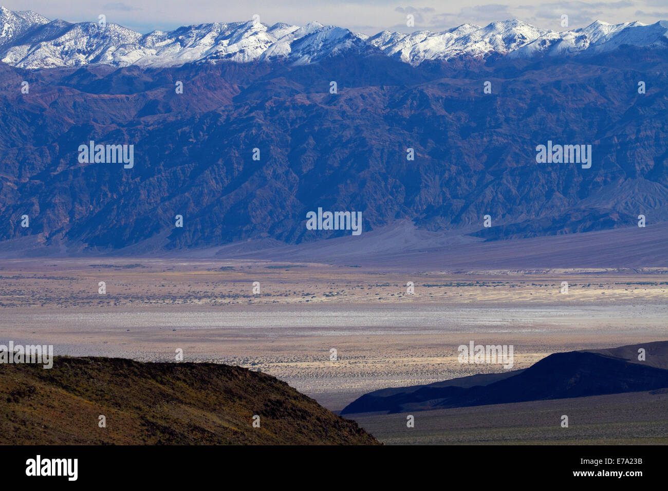Death Valley near Stovepipe Wells, and snow on Grapevine Mountains, Death Valley National Park, Mojave Desert, California, USA Stock Photo