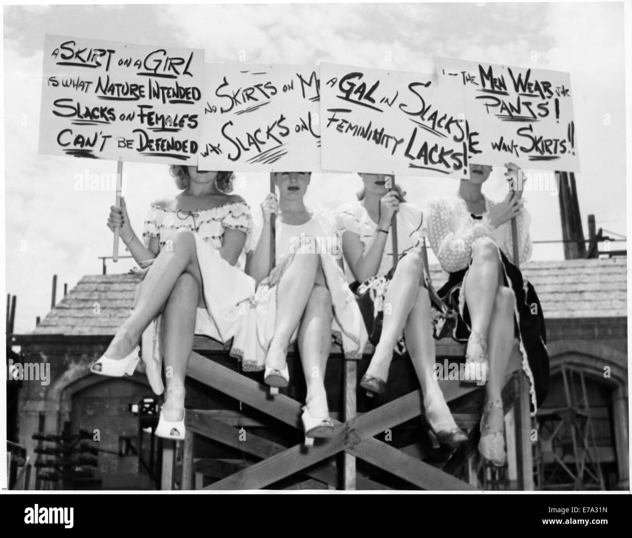 Group of 'Goldwyn Girls' in Skirts Holding Signs in Anti-Slacks Protest for their upcoming Film, 'The - Stock Image