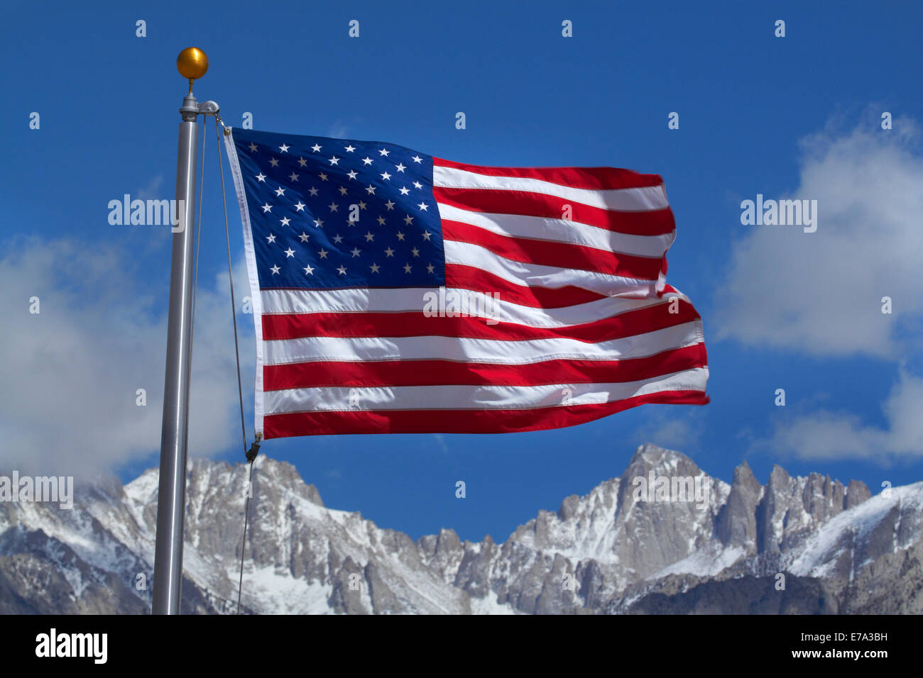 American flag and snow on Sierra Nevada Mountain Range, California, USA - Stock Image