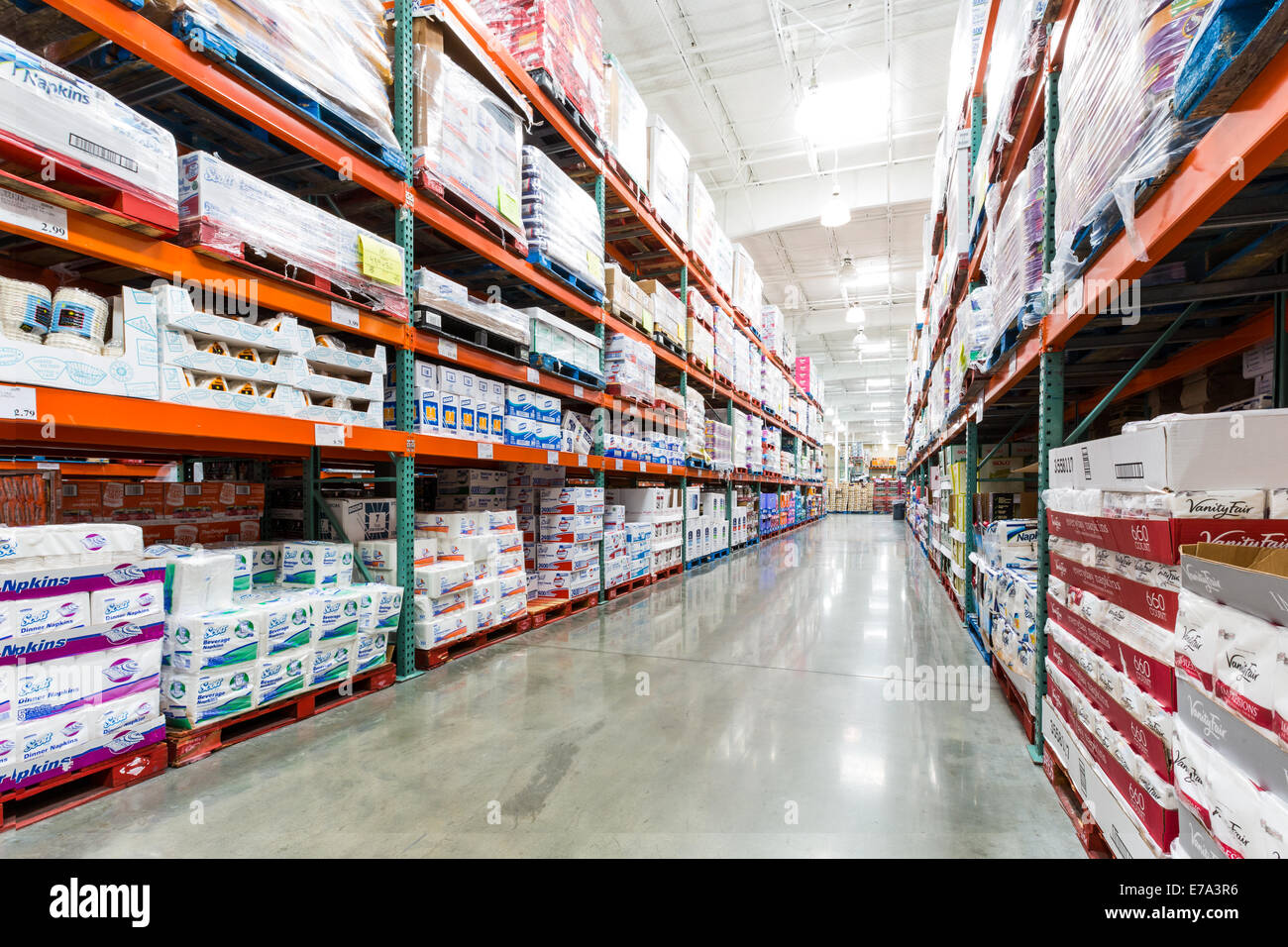Aisle in a Costco store with napkins, towels and other paper products - Stock Image