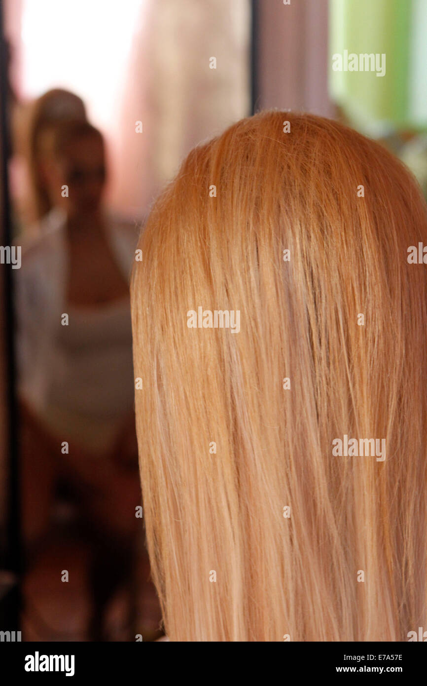 Bride prepare for her wedding. Hair extentions. - Stock Image