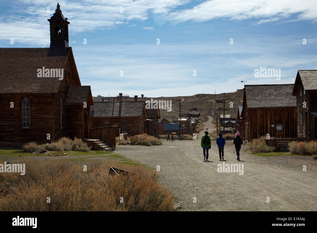 Methodist Church and tourists, Green Street, Bodie Ghost Town, Bodie Hills, Mono County, Eastern Sierra, California, - Stock Image