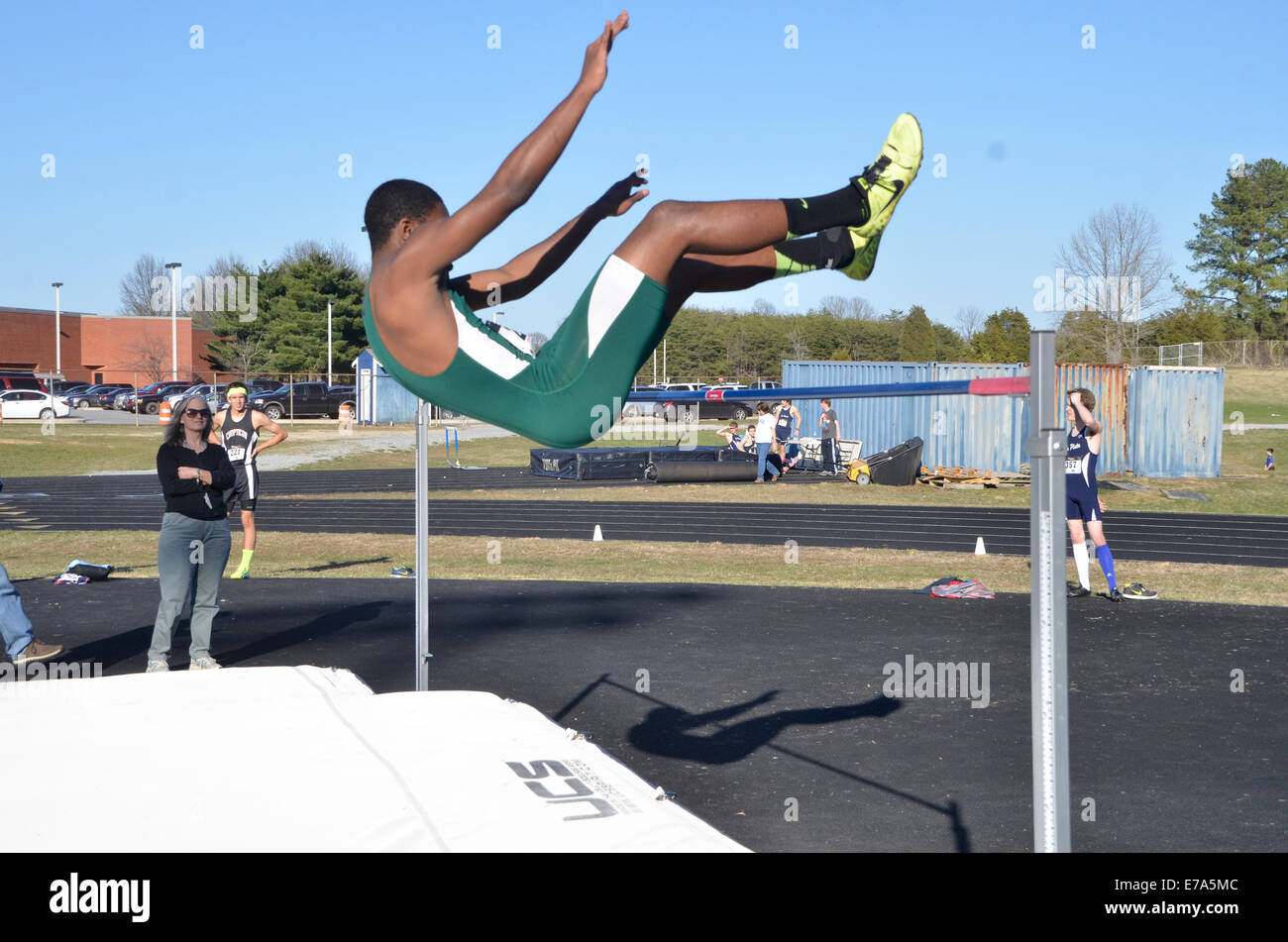 A high jump during a high school track and field event in Md - Stock Image