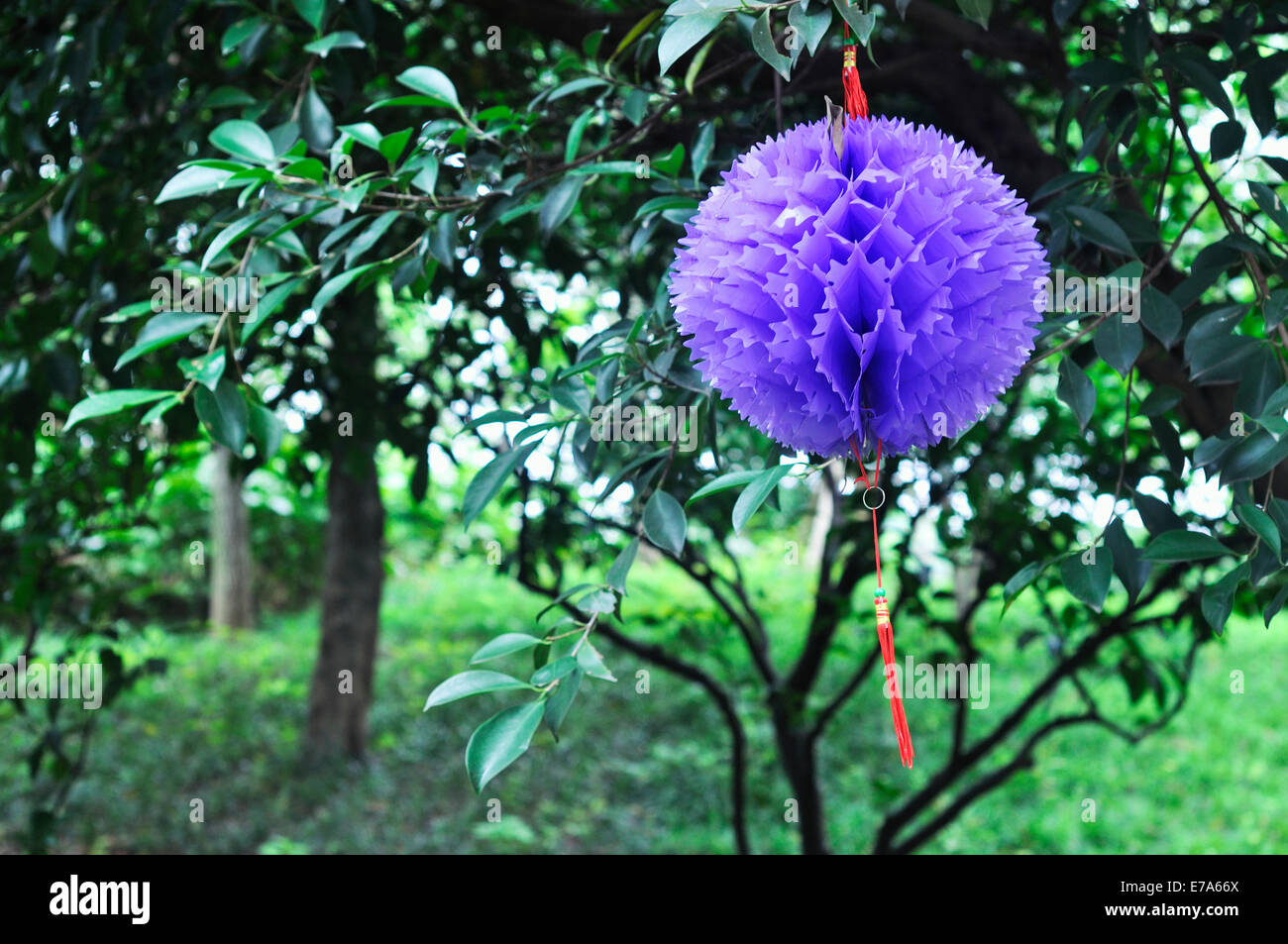 Origami paper flowers ball hanging on tree in childrens park in origami paper flowers ball hanging on tree in childrens park in china mightylinksfo