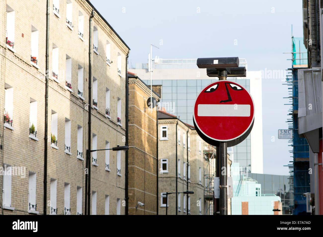 Graffiti on a No Entry street sign, John Fisher Street, London, England, UK. - Stock Image