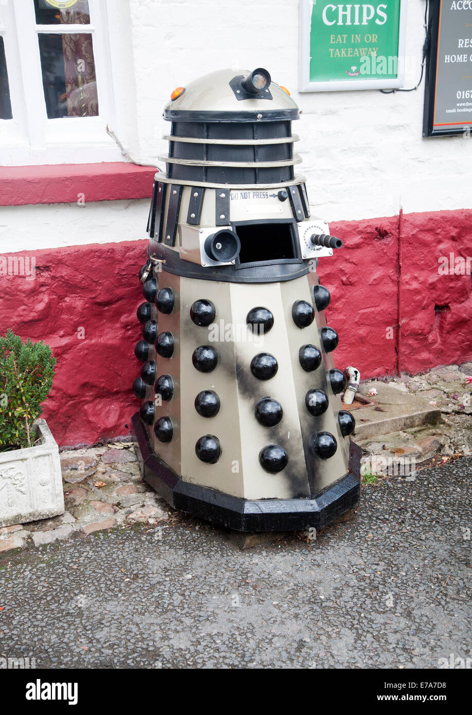 Dr Who Dalek model used as a waste bin, Aldbourne, Wiltshire, England - Stock Image