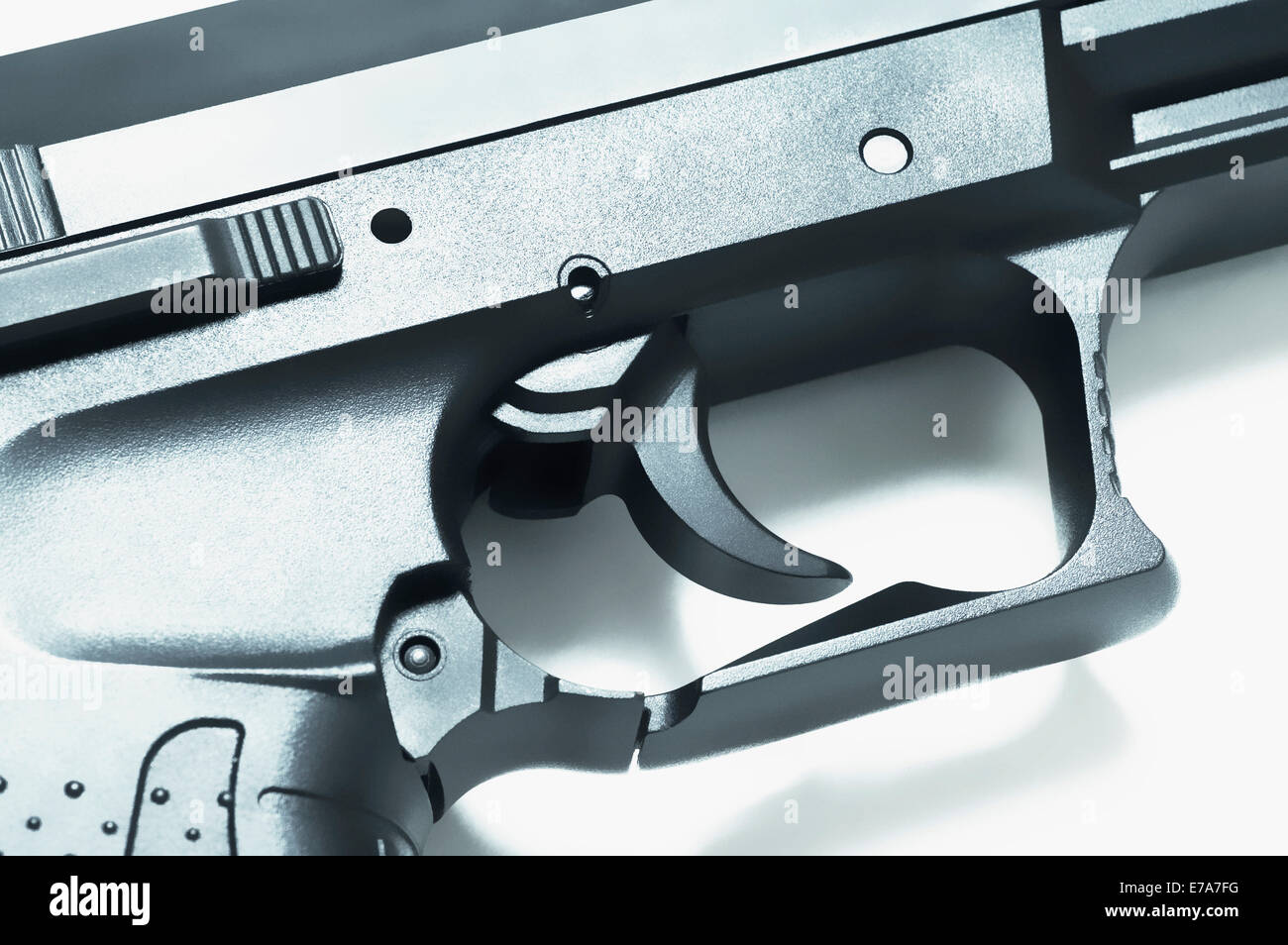 Close-up of the trigger on a handgun - Stock Image