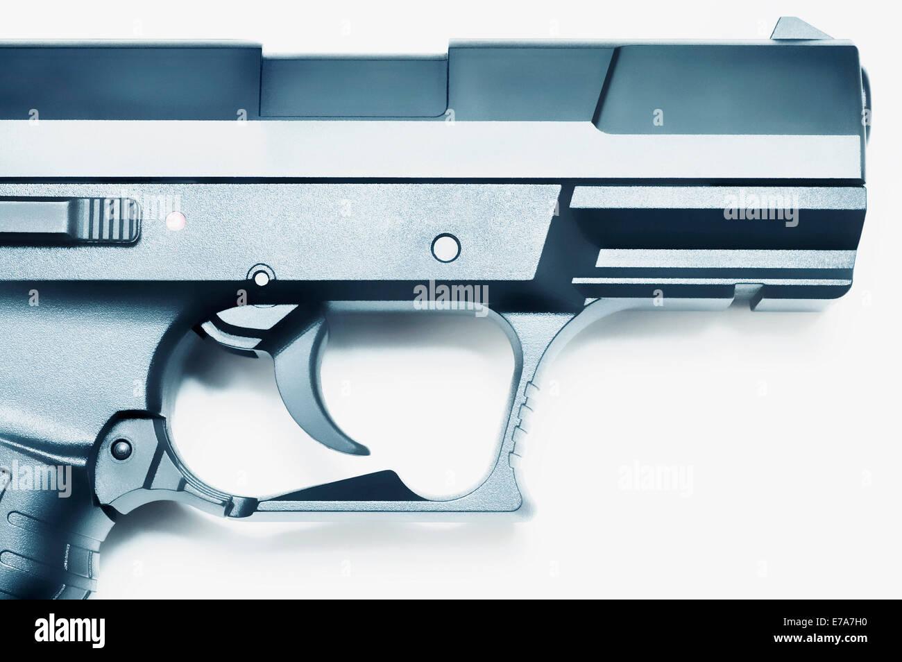 Close-up of trigger and barrel of a handgun - Stock Image
