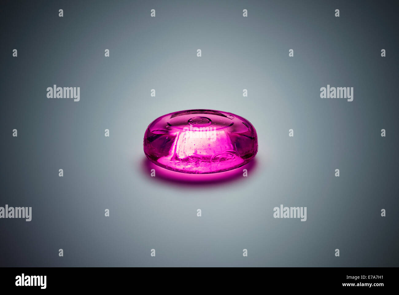 A piece of purple hard candy - Stock Image