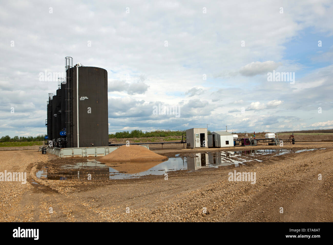 Row of oil storage tanks for cold heavy oil production with sand (CHOPS) Alberta, Canada Stock Photo