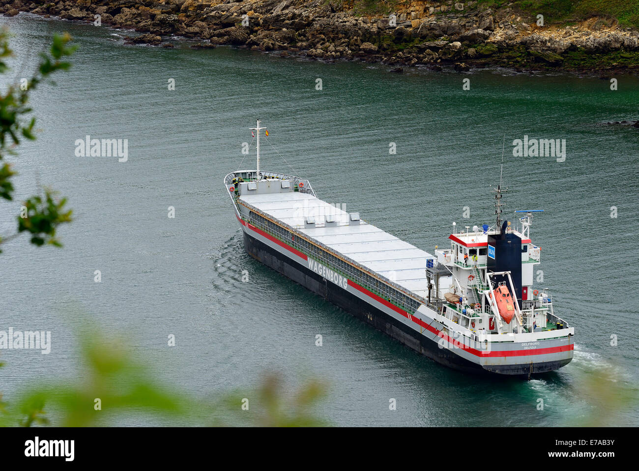 Cargo Ship leaving the Port of Pasajes; Guipuzkoa, Basque Country, Euskadi, Spain, Europe - Stock Image