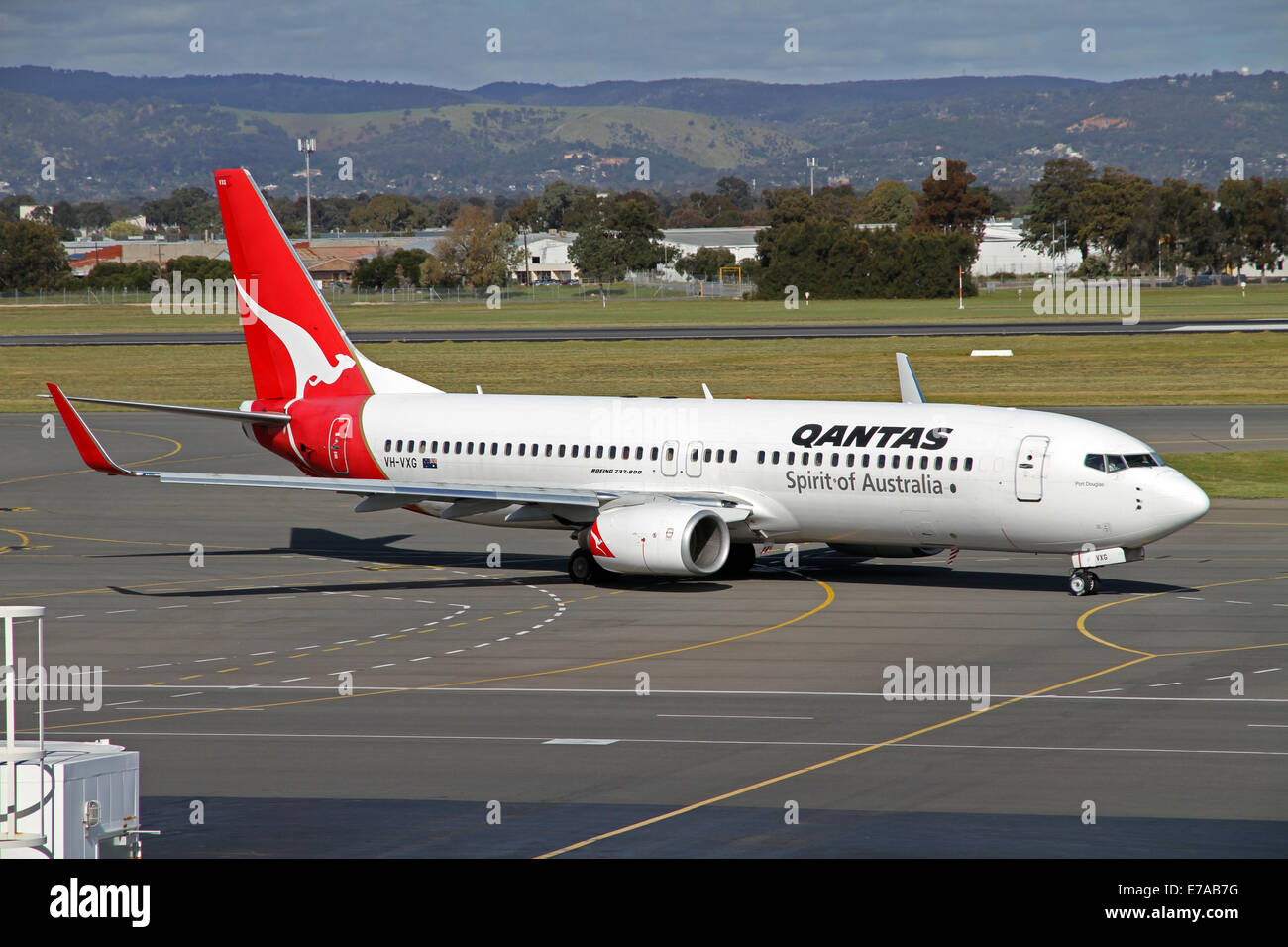 A Qantas Boeing 737-800 aircraft preparing to dock at an airbridge at Adelaide Airport Australia - Stock Image
