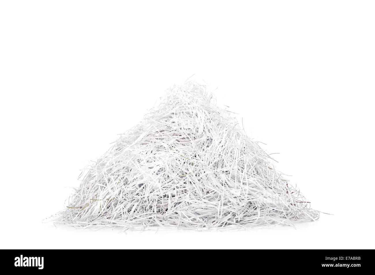 Studio shot of a pile of shredded paper isolated on white background - Stock Image