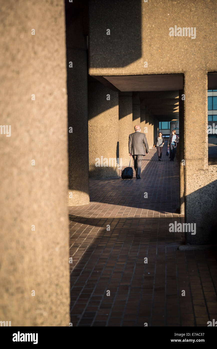 Barbican residential estate, People walking on passageway, City of London, UK - Stock Image