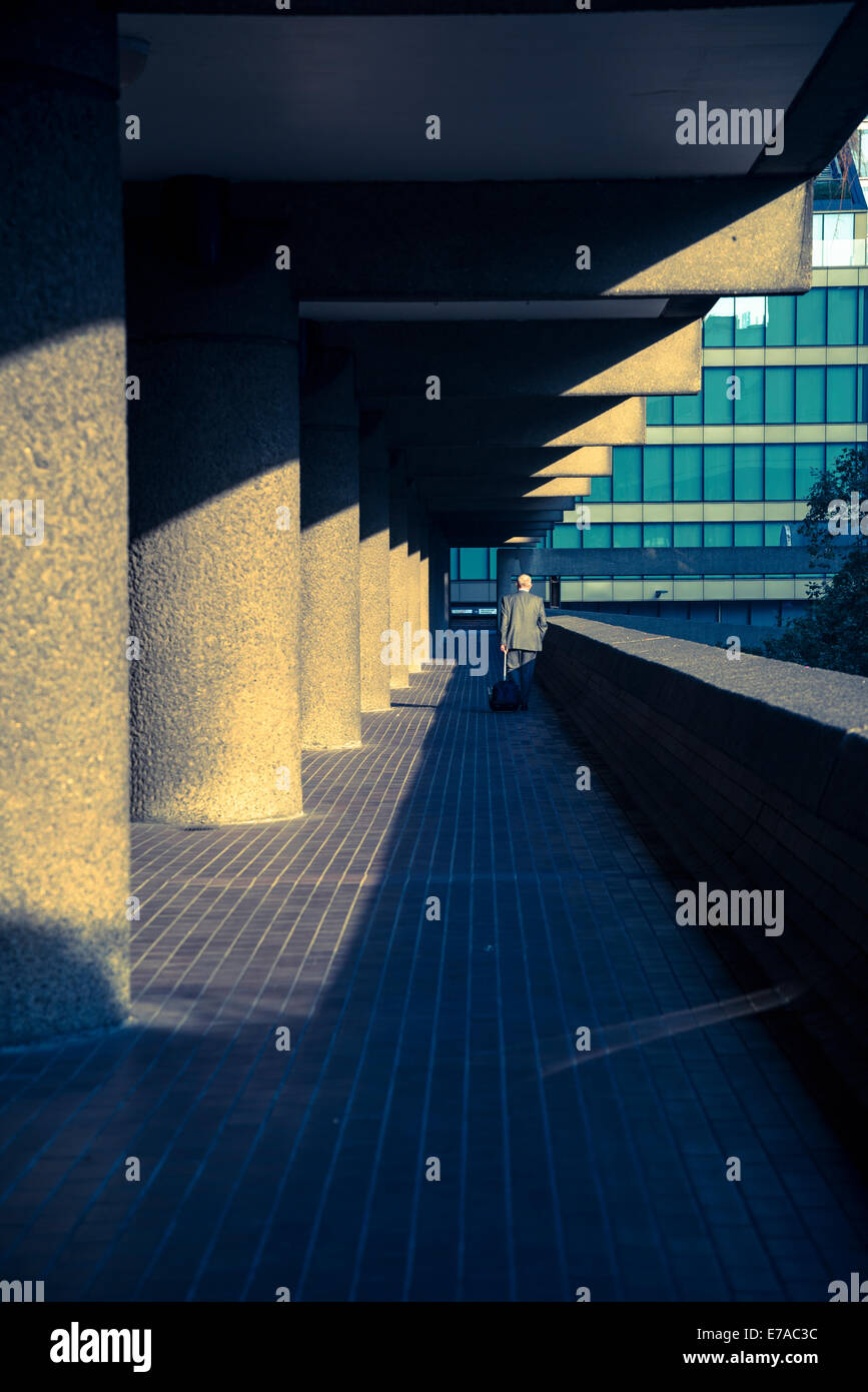Barbican residential estate, Person walking on passageway, City of London, UK - Stock Image